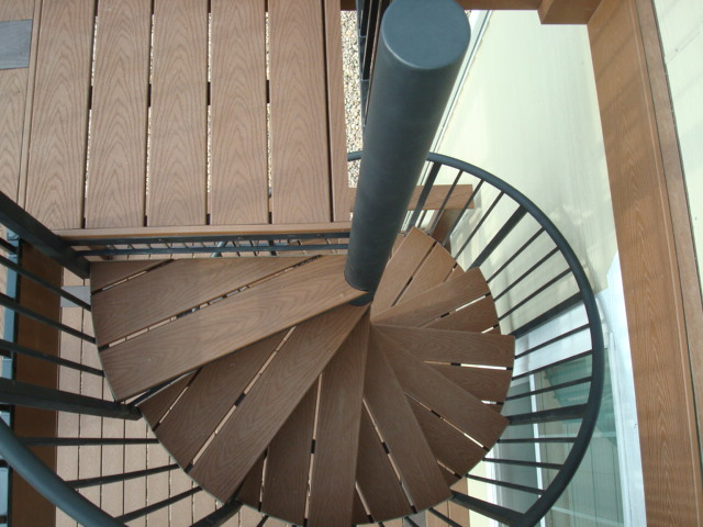 CUSTOM BLACK STEEL SPIRAL STAIRCASE WITH TREX SELECT SADDLE DECKING FOR  TREAD INLAYS :